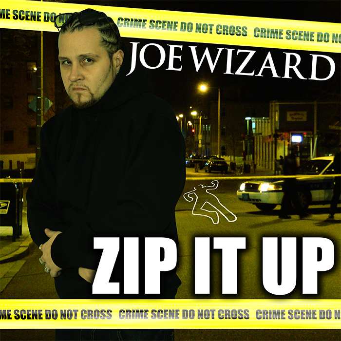 Joe Wizard cover art for Zip It Up is Joe at a crime scene with yellow tape